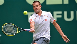 Russia's Mikhail Youzhny returns the bal